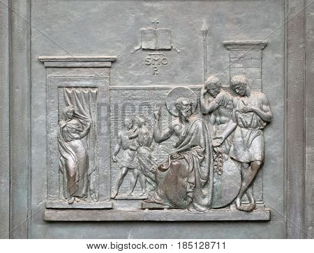 ROME, ITALY - SEPTEMBER 05: Bronze door with the image of the life of St. Paul: Paul teaching in Rome, basilica of Saint Paul Outside the Walls, Rome, Italy on September 05, 2016.