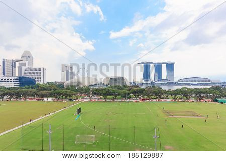 SINGAPORE - MAY 15, 2016: View of the downtown Singapore skyline taken from the National Gallery of Singapore art museum at blue sky with clouds.