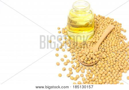 Soybeans in a wooden spoon isolated on a white backgroundcloseup