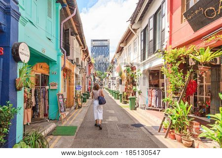 SINGAPORE - MAY 16, 2016: Fashion shop which is located in Haji Lane. It is shopping street in the heart of Singapores Kampong Glam Arab Quarter famous for shopscafes and restaurants.