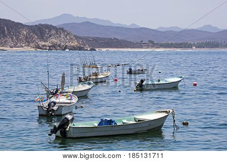 Fishing boats anchored in the Tehuamixtle Basy Mexican Pacific Ocean