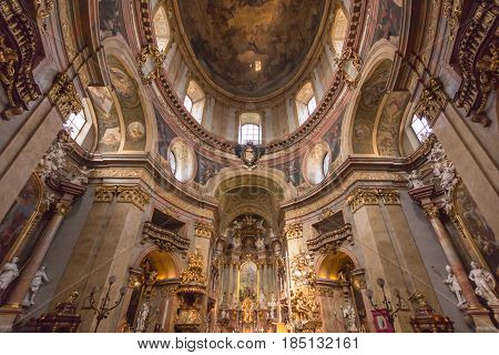 VIENNA AUSTRIA - APRIL 11: Presbytery and nave of baroque st. Peter church or Peterskirche by Antonio Galli da Bibiena und Martino Altomonte (altar paint) on April 11 2016 in Vienna Austria.