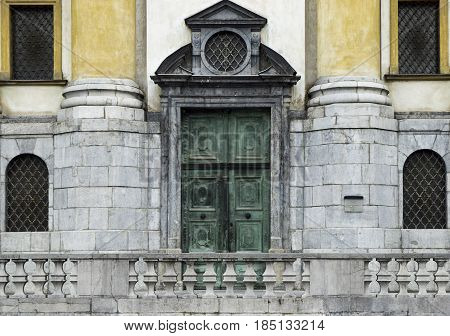 old green doors at church front entrance in Slovenia