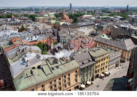 KRAKOW, POLAND - MAY 29, 2016: Aerial view of the roofs of houses in the northeastern historic part of Krakow. Poland. View from St Mary's Cathedral.