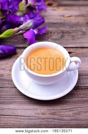 cup of fragrant black coffee on a gray table close up