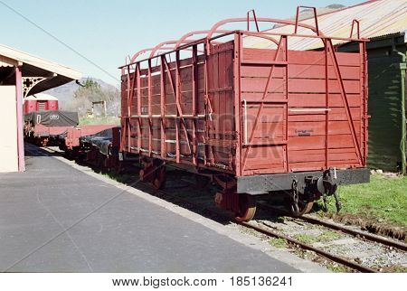 Old style railway freight carriages displayed on a disused siding with platform.