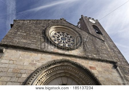 Detail of the gothic rose window on the facade of the Parish Church of Ponte de Lima Portugal