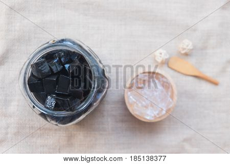 Grass jelly dessert in glass jar (focus grass jelly)