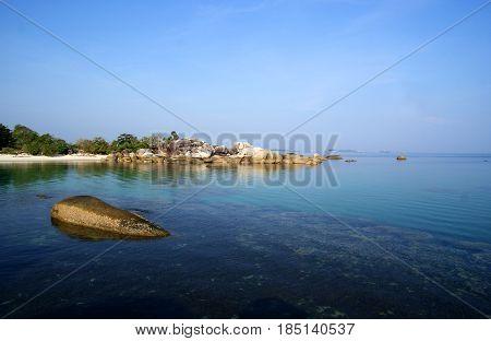 Tanjung Tinggi Beach is located in Belitung Island, Indonesia near the hamlet of Tanjung Tinggi