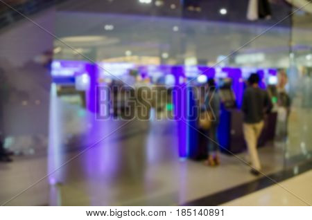 abstract blurred background people use ATM (Automatic Teller Machine) to Deposit Withdraw and Transfer Money at Bank