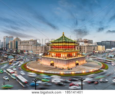 china xian in nightfall ancient bell tower with vehicles motion blur on rush hour