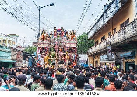 KOLKATA WEST BENGAL INDIA - 12TH AUGUST 2012 : Religious Hindu devotees pulling ropes of procession Lord Ram. Ram is a Hindu God based on whose life epic story