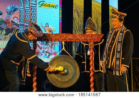 Kota Kinabalu,Sabah-May 31,2016:Sabah Chief Minister,Datuk Musa Aman beating the gong to officially open the Sabah state level Kaamatan Festival 2016 at KDCA Penampang,Sabah,Borneo.