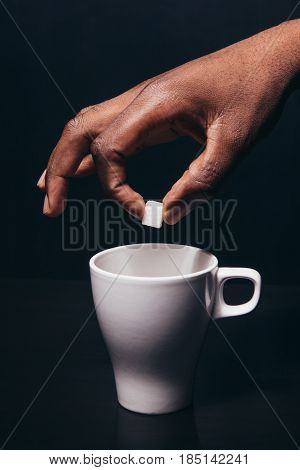 Black Man Hand Sugar White Cup Color Contrast Dark Background Sweet Drink Concept