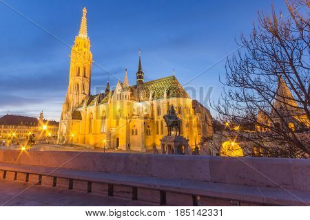 Night view of the Matthias Church is a Roman Catholic church located in Budapest, Hungary, in front of the Fisherman's Bastion at the heart of Buda's Castle District.