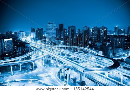 city interchange with blue tone expressway and viaducts in chengdu at night