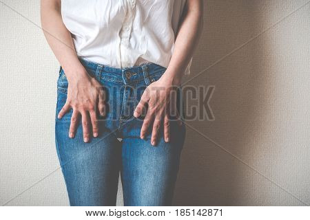 Women Touching Lower Abdomen