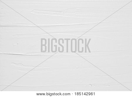 White sweet cream spread structure, abstract culinary background with free space for text. Backdrop of stucco wall, repair and construction.