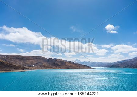 pure landscape in tibet holy lake and mountain with blue sky on tibetan plateau