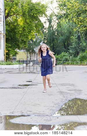 Cute running European girl with disheveled hair