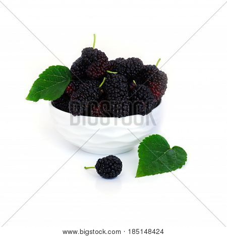 Mulberry n a dish with leaf Isolated on white background.