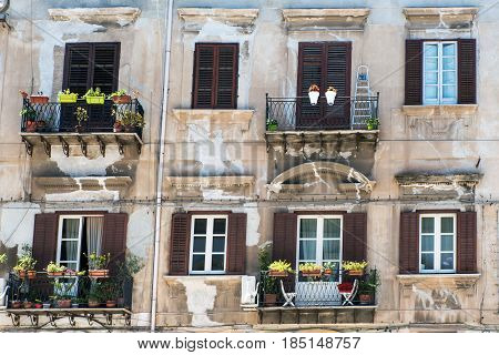 Facade of an old residential building in Palermo, Sicily