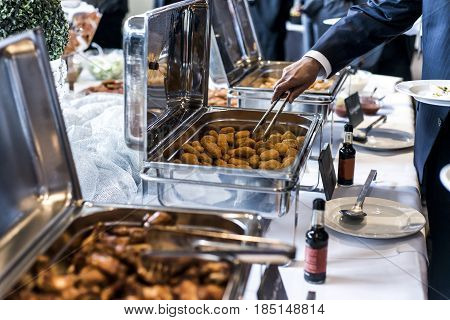 BBQ Chicken wings and nuggets with a spicy sauce during a business meeting buffet