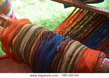 Traditional peruvian textile close-up on blurred background. Colorful woolen fabric