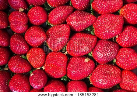 A background of fresh strawberry at the market San Miguel in Madrid Spain.