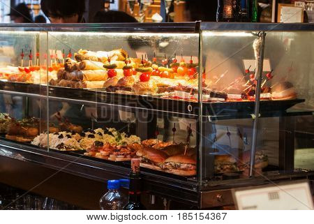 Madrid, Spain - February 12, 2017: Glass Case With Different Tapas At Madrid San Miguel Market, Spai