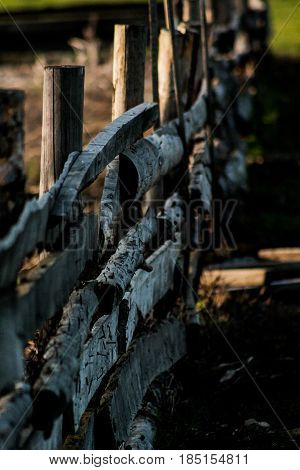 The fence on which sit two ravens. Beautiful almost collapsed wooden fence, very much in the spirit of the past.