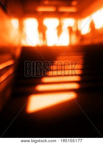 Diagonal orange metro station stairs bokeh background hd