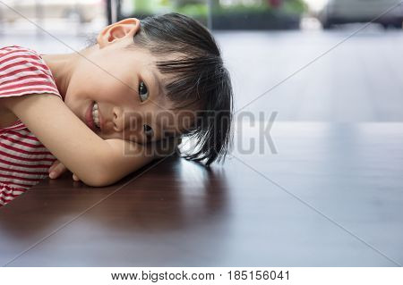 Asian Chinese Little Girl Lying On The Table