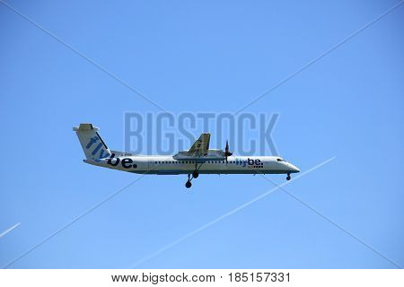 Amsterdam the Netherlands - May 5th 2016: G-ECOG Flybe De Havilland Canada DHC-8 approaching Schiphol Polderbaan runway arriving from Southampton United Kingdom