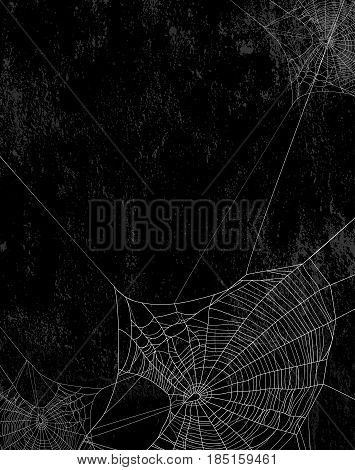 Spider web silhouette against black shabby wall - halloween theme vertical grunge background