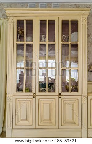 Interior decoration white cupboard with glass doors