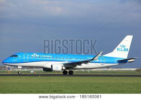 Amsterdam the Netherlands - April 7th 2017: PH-EXL KLM Cityhopper Embraer ERJ-175 takeoff from Polderbaan runway Amsterdam Airport Schiphol