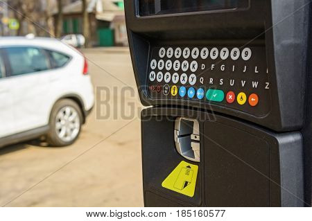 Close up of parking meter with colorful buttons in the street