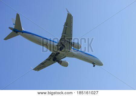 Amsterdam the Netherlands - April 9th 2017: PH-EZZ KLM Cityhopper Embraer ERJ-190STD approaching Polderbaan runway at Schiphol Amsterdam Airport the Netherlands