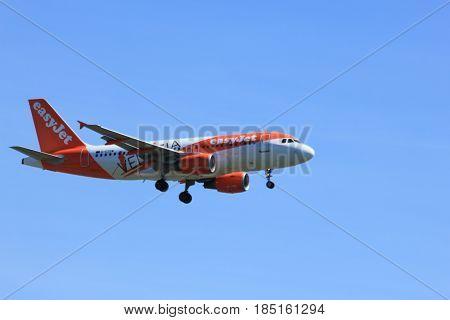Amsterdam the Netherlands - May 5th 2016: G-EZDW easyJet Airbus A319-111 approaching Schiphol Polderbaan runway arriving from Edinburgh United Kingdom