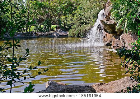 A small waterfall in the park in Sardinia