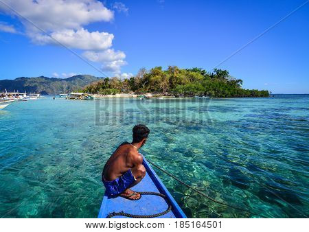 A man on boat in Coron Philippines. Coron is the third-largest island in the Calamian Islands in northern Palawan in the Philippines.