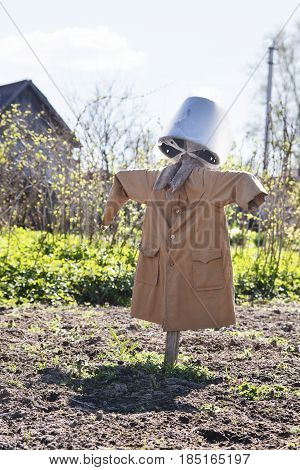 Scarecrow in a coat in the garden