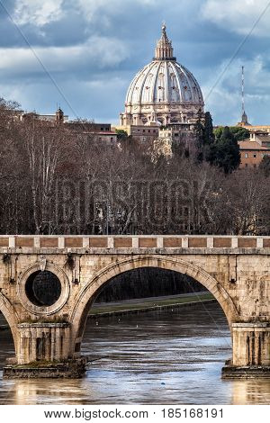 Sisto Bridge and the dome of Saint Peter. Rome Italy. Rome's historic center. Detail of a famous bridge in the Trastevere area in Rome. Basilica of Saint Peter and the Tiber River.