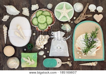 Rosemary herb and cucumber spa and skincare beauty treatment with bathroom accessories including ex foliating scrub, soap, moisturizing cream, bath crystals with shells and pearls.
