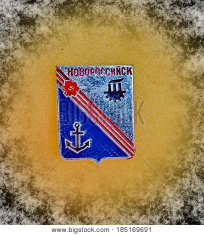 USSR - circa 1977: a badge with the coat of arms of the city of Novorossiysk, Krasnodar region from the series