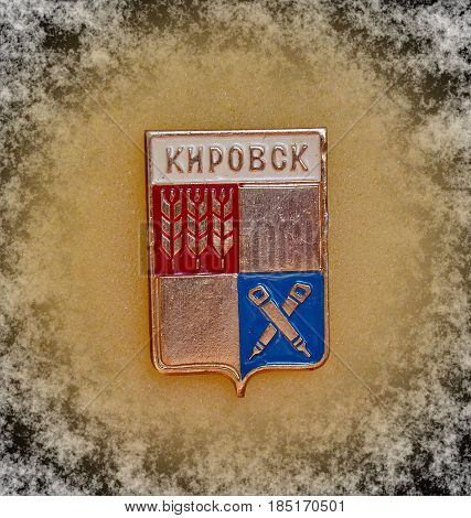 USSR - circa 1977: Badge with the coat of arms of the city of Kirovsk, Murmansk region from the series