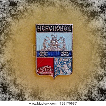USSR - circa 1977: a badge with the coat of arms of the city of Cherepovets, Vologda region from the series