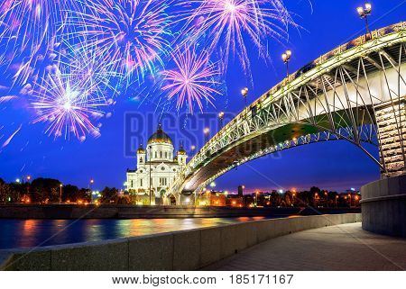 Christ the Savior Cathedral and Patriarshy Bridge in Moscow, Russia- beautiful night city landscape with fireworks in the sky.Night view of Moscow Russia - festive city landscape of Moscow Russia landmark with fireworks