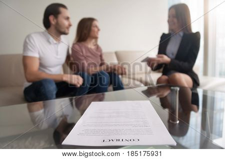 Young couple and businesswoman discussing prenuptial agreement, meeting with financial adviser or agent for investment, event wedding planner, health life insurance, focus on contract
